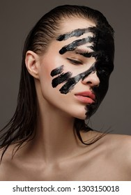 Portrait of fashion model. Black painting face make-up.