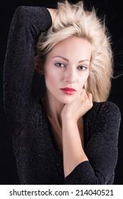 Portrait of fashion model on black background.