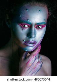 Portrait Fashion Model Woman Make Up. Girl with Warts. Creative Makeup. Blue color. Bodypainting