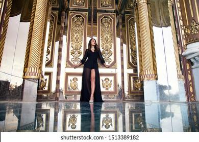Portrait of fashion serious beautiful woman is wearing black dress