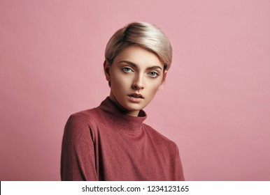 Portrait of fashion woman with blond short hair