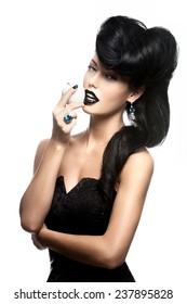 Portrait of fashion woman with modern hairstyle and  lips in black color with white apple