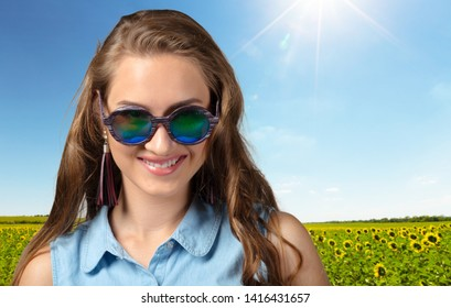 Portrait of fashion woman peeking over sunglasses. Female fashion model posing