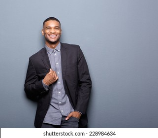 Portrait of a fashionable african american man smiling on gray background