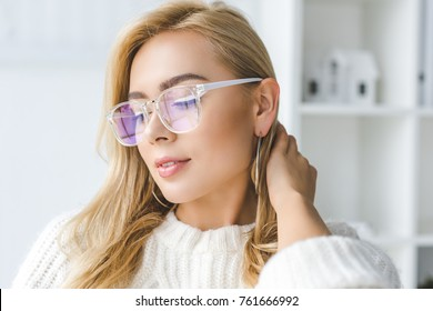 portrait of fashionable attractive blonde woman in eyeglasses