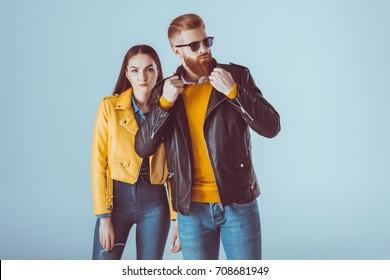 portrait of fashionable couple in leather jackets posing isolated on blue
