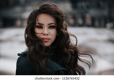 Portrait of fashionable girl at street