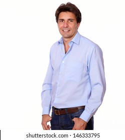 Portrait of a fashionable man smiling at you while standing in white background