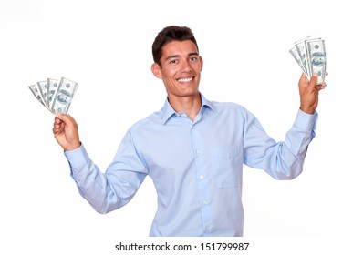 A portrait of a fashionable man standing and holding cash dollars while standing and smiling at you on isolated studio