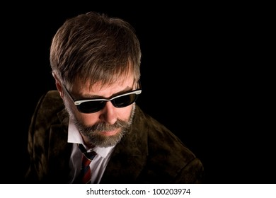 Portrait of a fashionable middle aged man wearing sunglasses