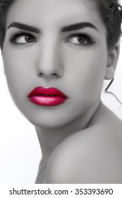 Portrait of a fashionable model with sexy red lips Black and white, beautiful naked shoulders and perfect skin. Close up.
