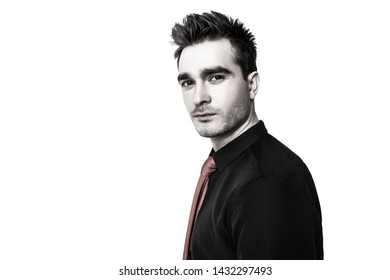 A portrait of a fashionable young man posing in the studio over the white background. Casual classic fashion for men, beauty.