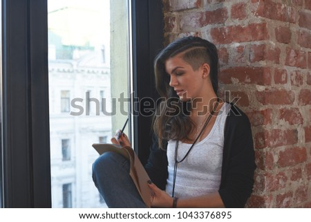 Portrait of fashionable young mixed race hipster girl with shaved side  haircut sitting on windowsill 37dada2a9