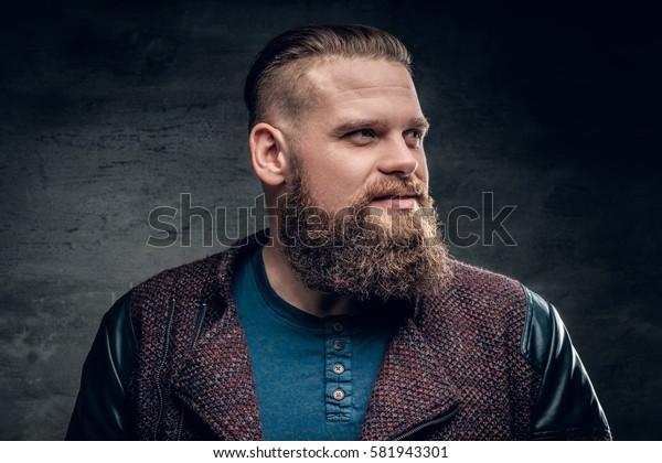 Portrait of fat bearded male dressed in a jacket.