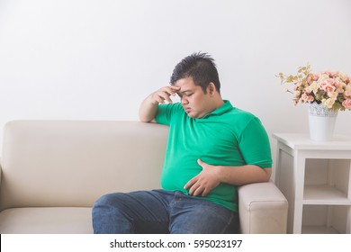Portrait of Fat obese man thinking about his weight problem