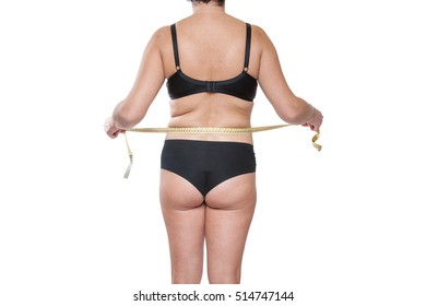 Portrait Fat Woman with Measuring tape Around her belly, concept to Start Diet. Fat Woman in Underwear. Female Body with Excess of Subcutaneous Fat and cellulite, Girl on White Background in Underwear