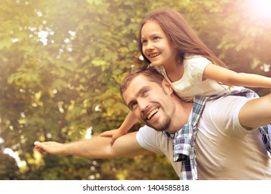 Portrait of father with daughter in summer park