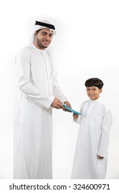 Portrait of father giving gift to his son