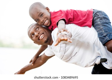 Portrait of father with his son having fun in the park in summer. Happy family fun boy playing with dad summer nature outdoors