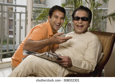 Portrait of father and son having fun