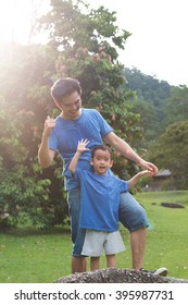 Portrait of father and son in the park