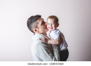 Portrait of father and son's baby. Fatherhood, love and protection of children. Concert of family and continuity of generations