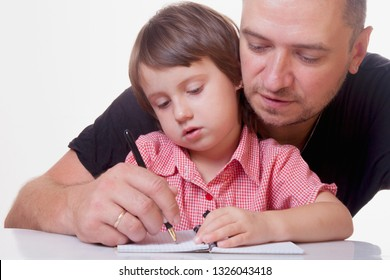 Portrait of father teaching daughter learn to write. Education, home, education, family concept.