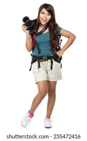 portrait of female backpacker going on vacation with backpack and camera