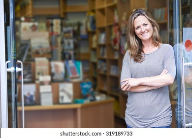 Portrait Of Female Bookshop Owner Outside Store