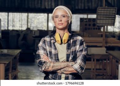 Portrait of female carpenter wearing protective eyewear - Shutterstock ID 1796696128