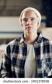 Portrait of female carpenter wearing protective eyewear - Shutterstock ID 1901378938