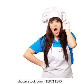 portrait of female chef shocked on white background