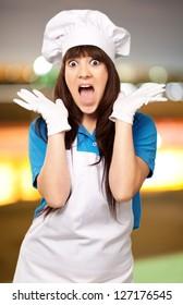 portrait of female chef surprised, outdoor