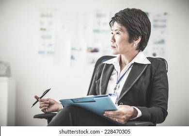 Portrait of female chief sitting in her office