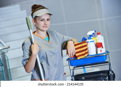 portrait of female cleaner in uniform with mop and cleaning equipment