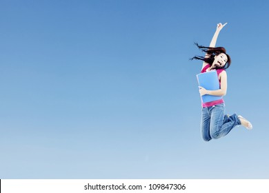 Portrait of female college student on blue sky with clear sky can be used as copy space