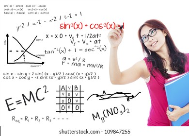 Portrait of female college student using marker to write math formula on the whiteboard