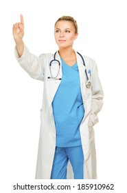 A portrait of a female doctor pointing, close-up, isolated on white