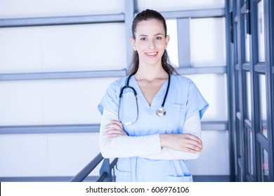 Portrait of female doctor standing with arms crossed in hospital