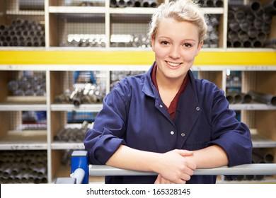Portrait Of Female Engineering Apprentice In Store Room