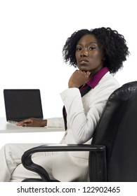 Portrait of a female executive sitting on her office