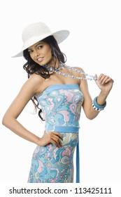 Portrait of a female fashion model posing against white background
