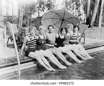 Portrait of female friends at pool