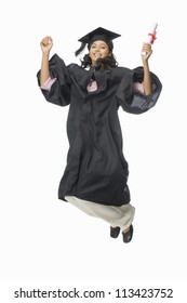 Portrait of a female graduate cheering with her diploma