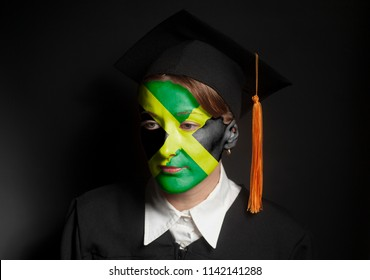 Portrait of Female Jamaica bachelor with painted Jamaica flag in Black mantle and Graduation Cap on black