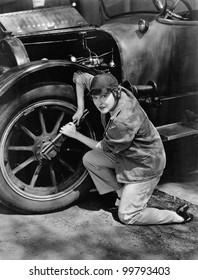 Portrait of female mechanic working