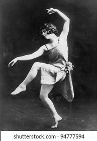 Portrait of female modern dancer performing