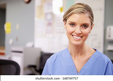 Portrait Of Female Nurse Working At Nurses Station