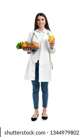 Portrait of female nutritionist with healthy products on white background