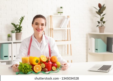 Portrait of female nutritionist with healthy products in her office